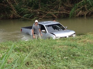 Chris Biro helping stranded vehicle after flooding